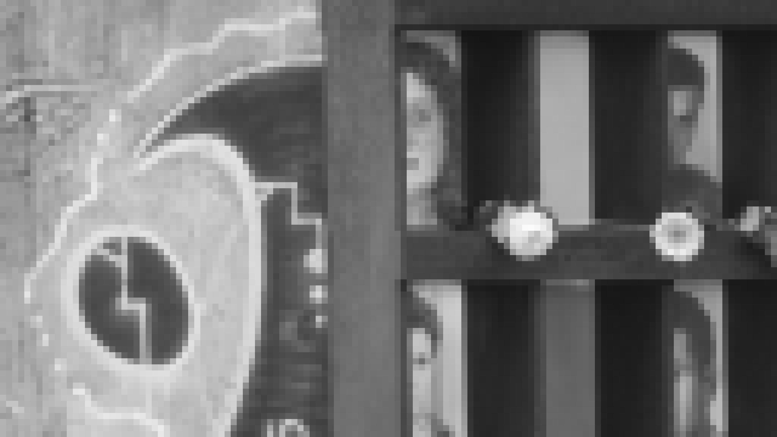 """Vor einem Abschnitt der ehemaligen Mauer an der Bernauer Straße sind in vier """"Fenstern des Gedenkens"""" – so der Name der Gedenkstelle – die fotografisch angeschnittenen Porträts von Maueropfern zu sehen. An zwei Fensterkreuzen sind Blumen befestigt."""