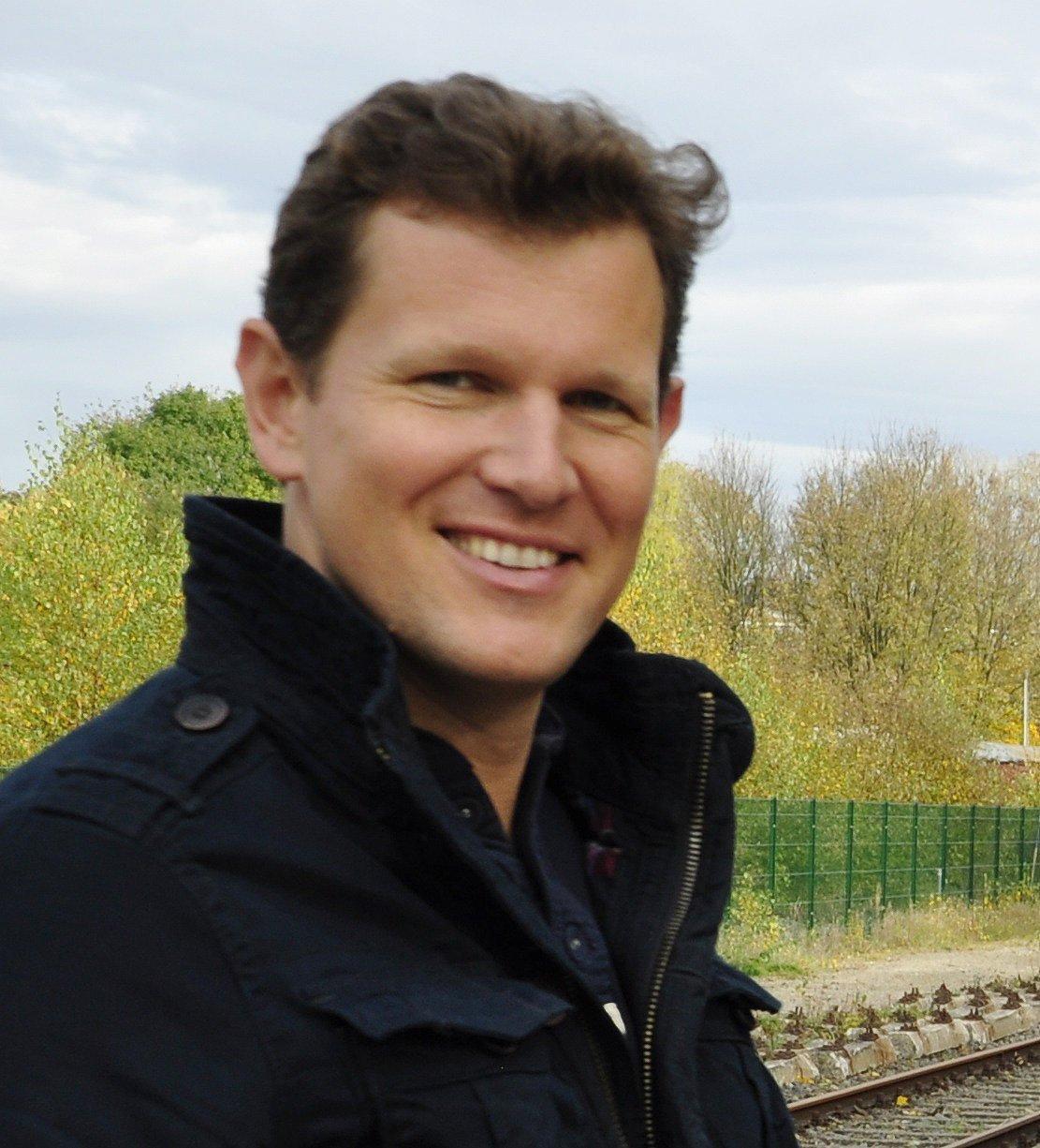 Eine Porträtaufnahme des lächelnden Carsten Gerhardt.