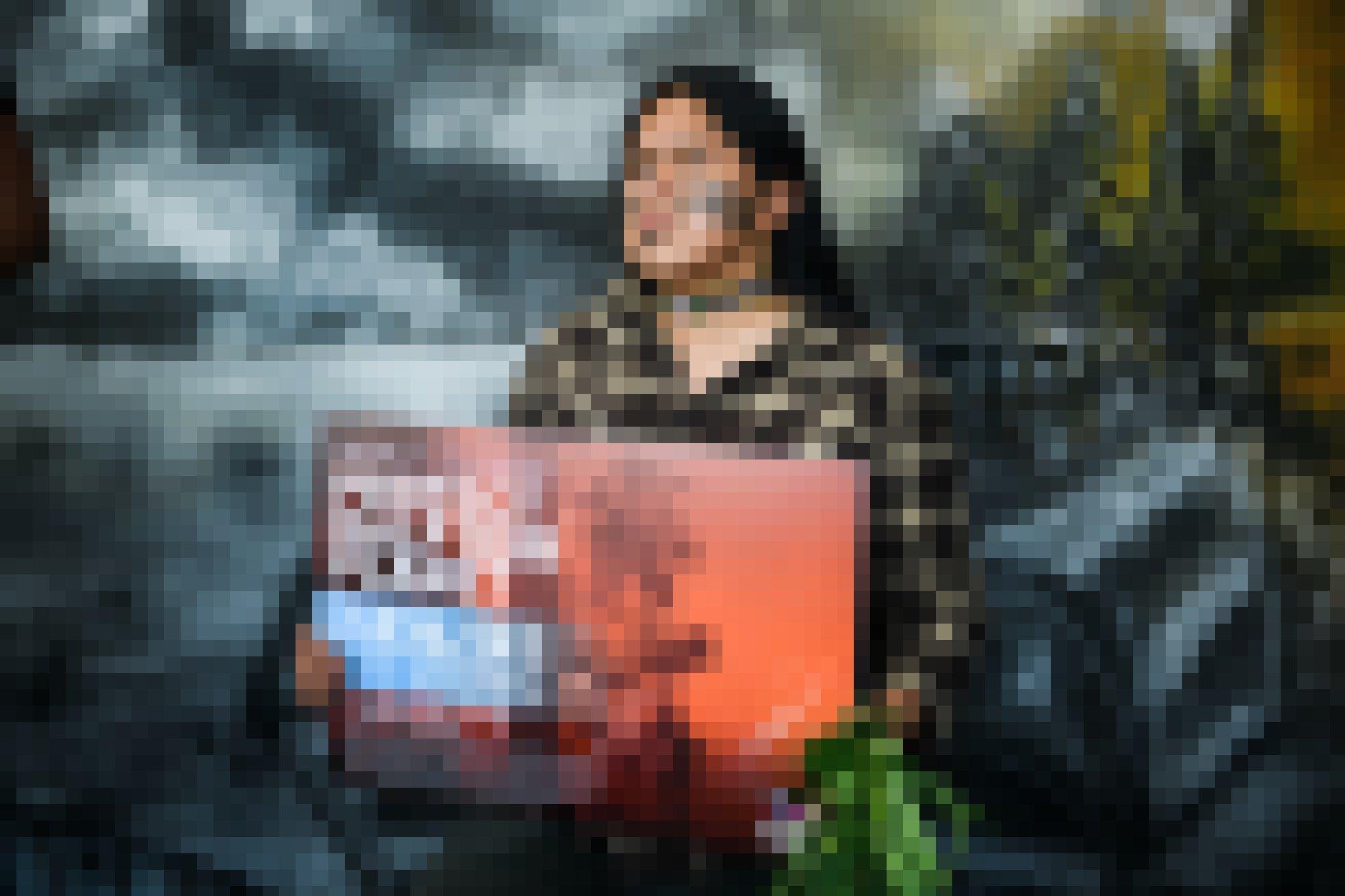 Eine Vertreterin der Abordnung aus dem amazonischen Tiefland hält ein Plakat mit der Forderung, 50Prozent des Planeten zu schützen