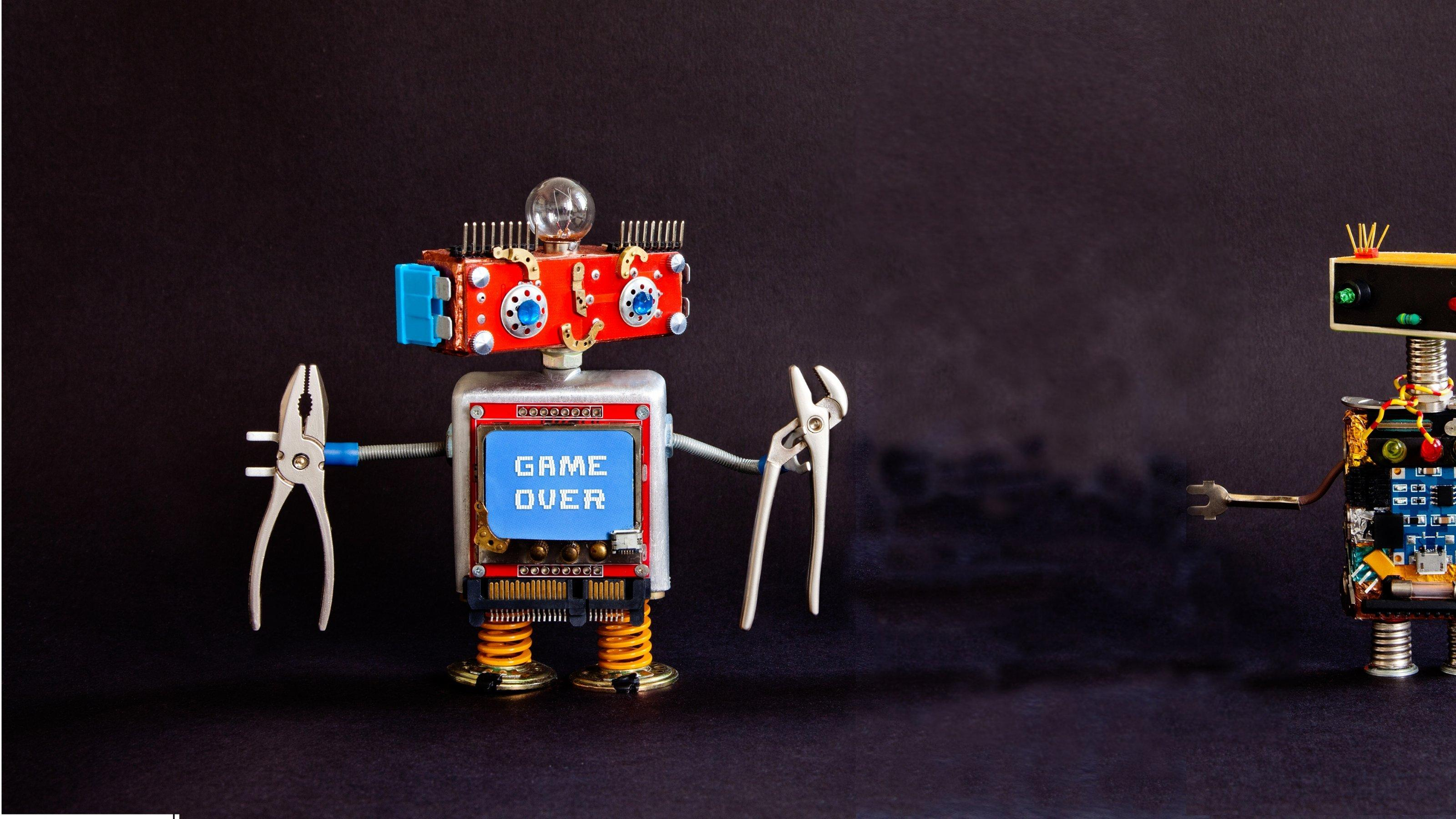 Two journalism roboter with tools