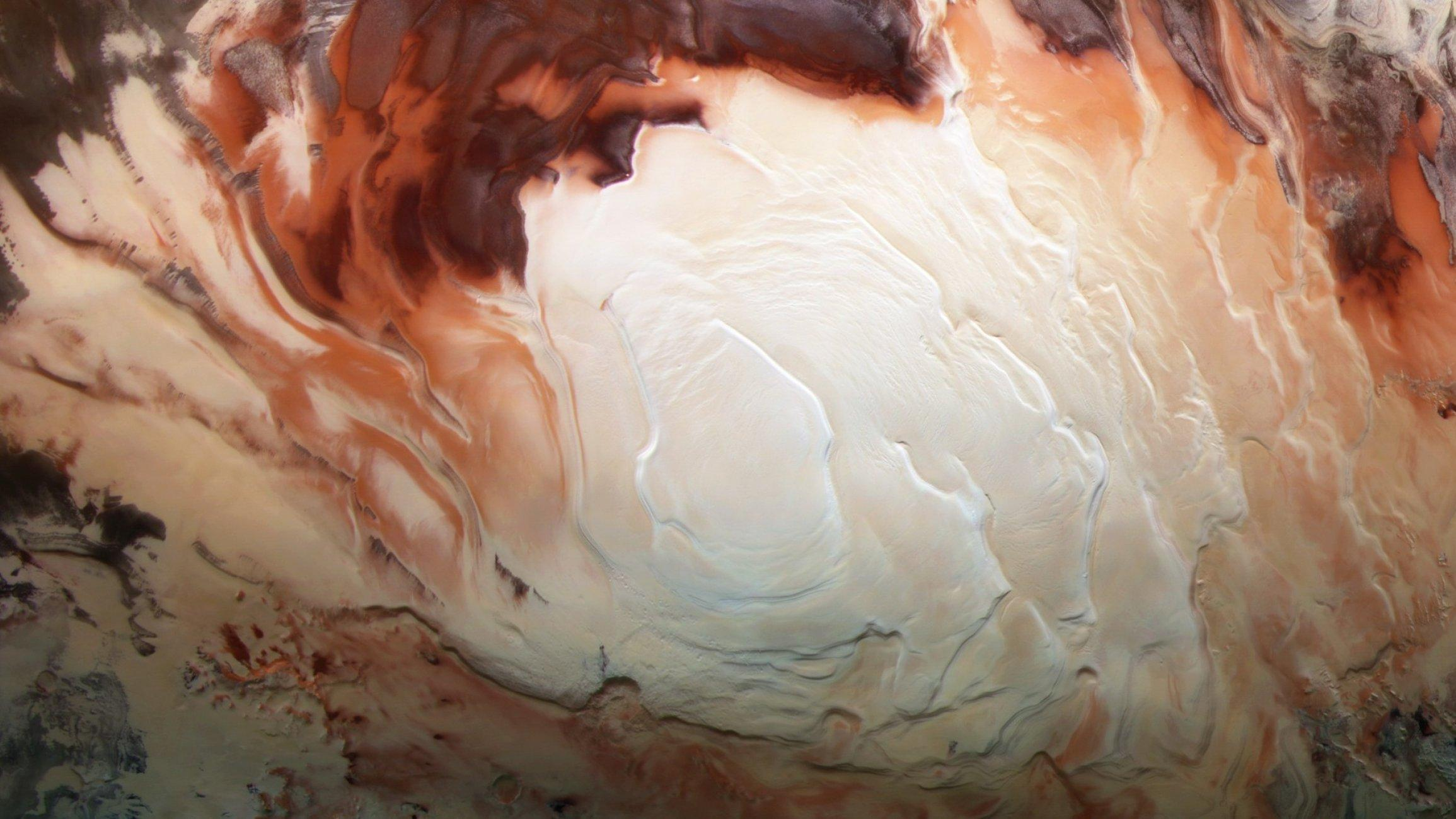 Der Südpol des Mars mit den spiralförmig gedrehten Gletschern wirkt wie der Schaum auf einer Tasse Cappuccino